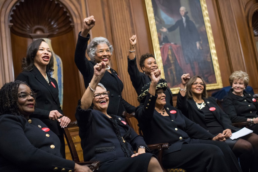UNITED STATES - JANUARY 30: From left, Reps. Gwen Moore, D-Wis., Lisa Blunt Rochester, D-Del., Bonnie Watson Coleman, D-N.J., Joyce Beatty, D-Ohio, Alma Adams, D-N.C., Barbara Lee, D-Calif., Robin Kelly, D-Ill., and Del. Madeleine Bordallo, D-Guam, wear black during a photo op in the Capitol's Rayburn Room to show solidarity with men and women who are speaking out against sexual harassment and discrimination on January 30, 2018. (Photo By Tom Williams/CQ Roll Call)