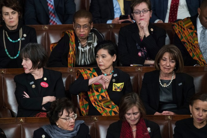 """UNITED STATES - JANUARY 30: Rep. Judy Chu, D-Calif., gives a """"thumbs down"""" during President Donald Trump's State of the Union address to a joint session of Congress in the House chamber on January 30, 2018. (Photo By Tom Williams/CQ Roll Call)"""