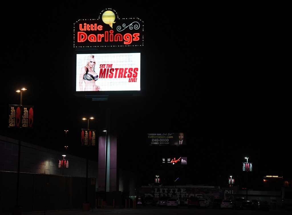 A sign at Little Darlings Las Vegas advertises an upcoming performance at the strip club by adult film actress/director Stormy Daniels on January 25, 2018. (Ethan Miller/Getty Images)