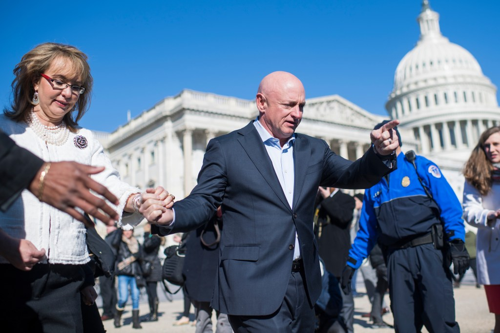 UNITED STATES - MARCH 23: Mark Kelly and his wife former Rep. Gabrielle Giffords, D-Ariz., are seen after a news conference with lawmakers at the House Triangle to call on Congress to act on gun safety legislation on March 23, 2018. (Photo By Tom Williams/CQ Roll Call)