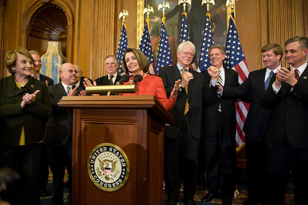 Speaker Nancy Pelosi, flanked by House Democratic leaders, holds a news conference following passage of the House healthcare reform legislation on Saturday night, Nov. 7, 2009.