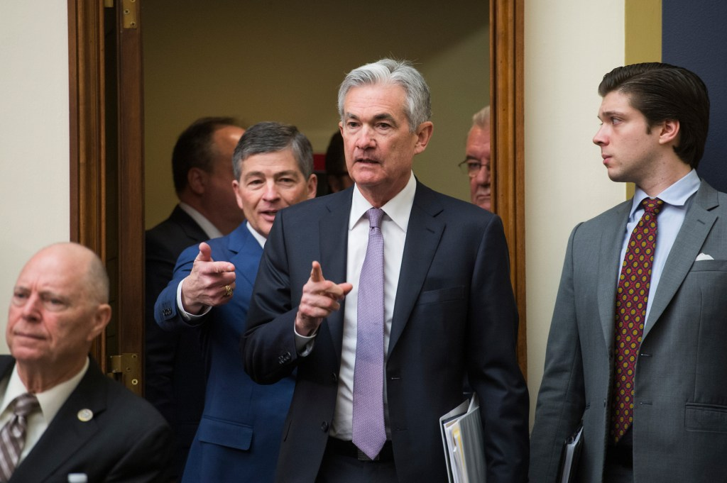 "UNITED STATES - FEBRUARY 27: Federal Reserve Chairman Jerome Powell, center, and House Financial Services Committee Chairman Jeb Hensarling, R-Texas, left, arrive for a hearing titled ""Monetary Policy and the State of the Economy"" in Rayburn Building on February 27, 2018. (Photo By Tom Williams/CQ Roll Call)"