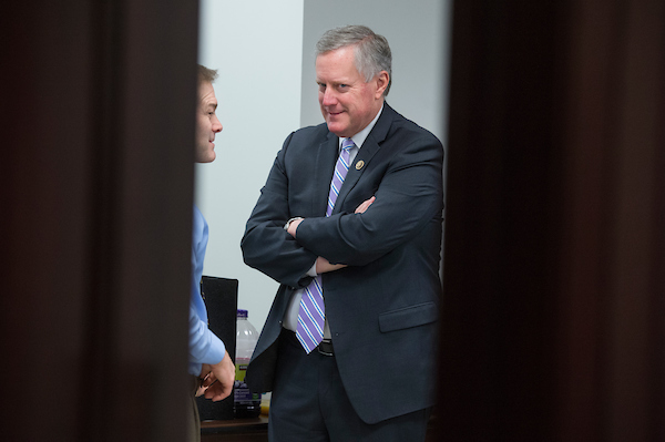 UNITED STATES - MARCH 06: Rep. Mark Meadows, R-N.C., right, talks with Rep. Jim Jordan, R-Ohio, in the Capitol after a meeting of the House Republican Conference on March 06, 2018. (Photo By Tom Williams/CQ Roll Call)