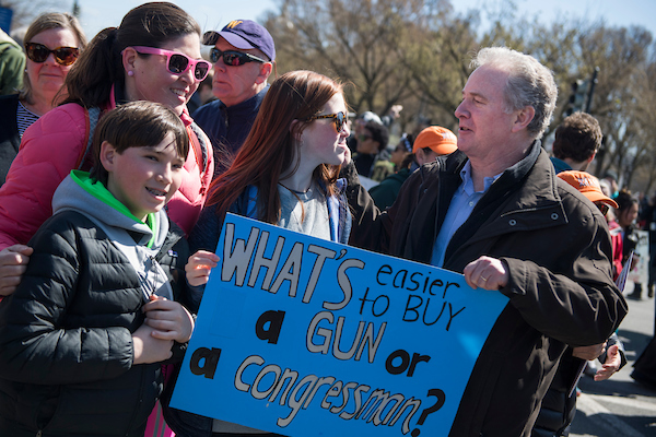 Sen. Chris Van Hollen, D-Md., greets supporters near the student-led March for Our Lives on Saturday. (Tom Williams/CQ Roll Call)