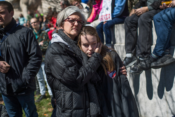 Lori Kerr of Capitol Hill, and her daughter Lia, 12, listen to speakers at Saturday's rally. (Tom Williams/CQ Roll Call)