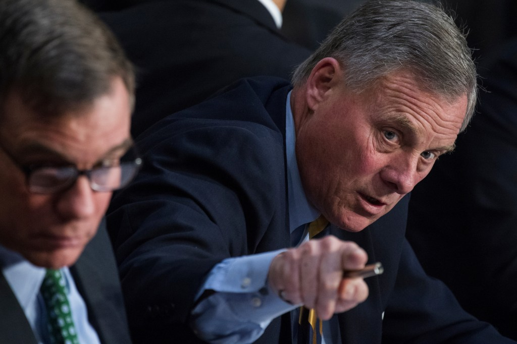 UNITED STATES - MARCH 21: Chairman Richard Burr, R-N.C., right, and ranking member Sen. Mark Warner, D-Va., conduct a Senate Intelligence Committee hearing in Hart Building on Russian Interference in the 2016 election on March 21, 2018. Homeland Security Secretary Kirstjen Nielsen, and former Secretary Jeh Johnson, testified. (Photo By Tom Williams/CQ Roll Call)
