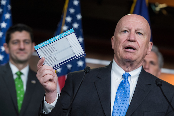 UNITED STATES - APRIL 17: Ways and Means chairman Rep. Kevin Brady, R-Texas, holds a sample of a postcard-style tax filing during a news conference in the House studio after a meeting of the GOP Conference on April 17, 2018. House Majority Leader Kevin McCarthy, R-Calif., right, and Speaker Paul Ryan, R-Wis., also appear.(Photo By Tom Williams/CQ Roll Call)