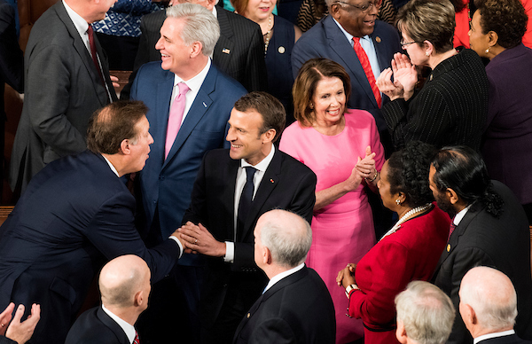 French President Emmanuel Macron shakes hands with members of Congress as he arrives to address both the House and Senate in a joint meeting of Congress on Wednesday, April 25, 2018. (Photo By Bill Clark/CQ Roll Call)