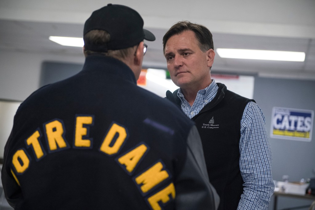 UNITED STATES - APRIL 4: Rep. Luke Messer, R-Ind., right, who is running for the Republican nomination for Senate in Indiana, talks with a voter at the Kosciusko County Republican Fish Fry in Warsaw, Ind., on April 4, 2018. (Photo By Tom Williams/CQ Roll Call)