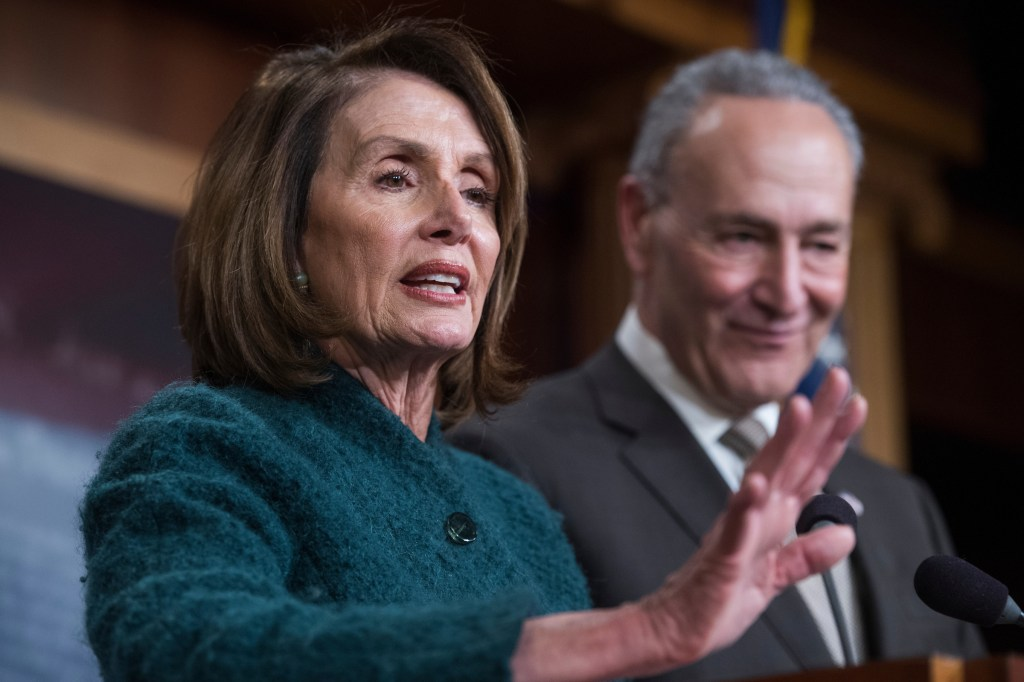 House Minority Leader Nancy Pelosi, D-Calif., and Senate Minority Leader Charles Schumer, D-N.Y., conduct a news conference in the Capitol on the passage of the omnibus spending bill in the House. (Photo By Tom Williams/CQ Roll Call)