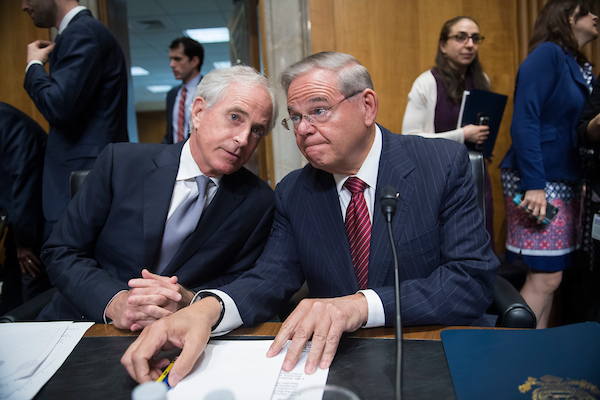 UNITED STATES - APRIL 23: Chairman Bob Corker, R-Tenn., left, and ranking member Sen. Bob Menendez, D-N.J., confer before a Senate Foreign Relations committee markup in Dirksen Building on the nomination of Mike Pompeo to be secretary of state on April 23, 2018. (Photo By Tom Williams/CQ Roll Call)