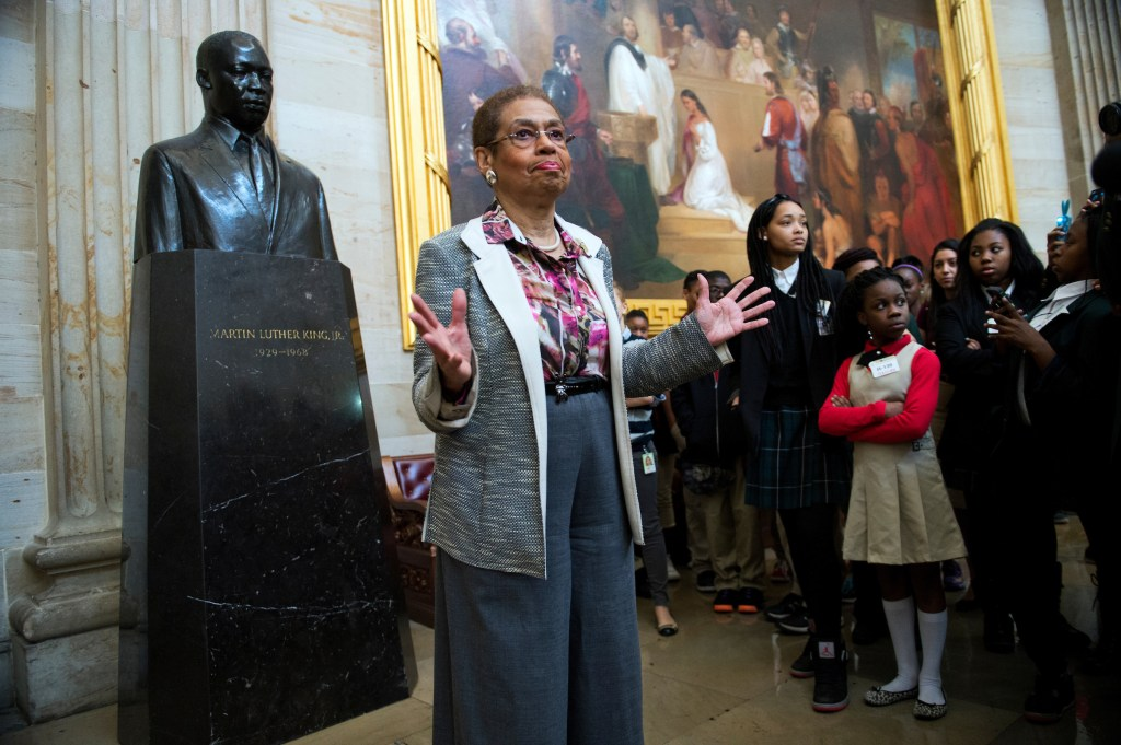 UNITED STATES - FEBRUARY 20: Del. Eleanor Holmes Norton, D-D.C., talks about a statue of Martin Luther King, Jr., during a tour of the Capitol rotunda that she gave to about 60 D.C. students. The tour of the House floor, rotunda, and emancipation hall, was in honor of Black History Month which is February. (Photo By Tom Williams/CQ Roll Call)