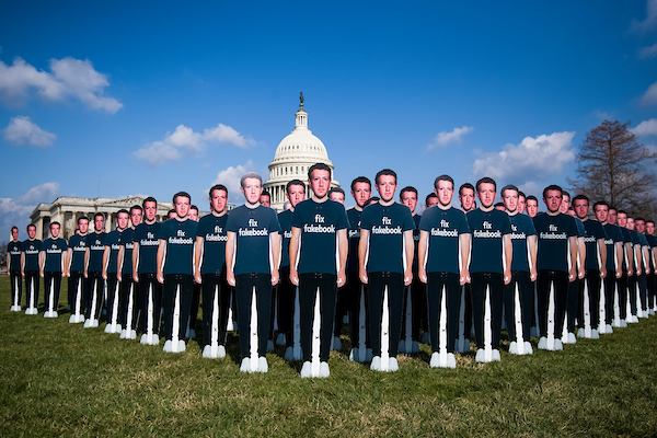Cutouts of Facebook CEO Mark Zuckerberg appear on the east lawn of the Capitol ahead of his testimony before a joint hearing of the Senate Judiciary and Commerce Committees on the protection of user data on April 10, 2018. Avaaz set up the display to call on Facebook to delete fake accounts. (Photo By Tom Williams/CQ Roll Call)
