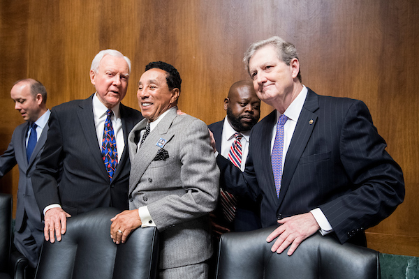 UNITED STATES - MAY 15: From left, Sen. Orrin Hatch, R-Utah, recording artist Smokey Robinson, and Sen. John Kennedy, R-La., pose for the cameras before the start of the Senate Judiciary Committee hearing on