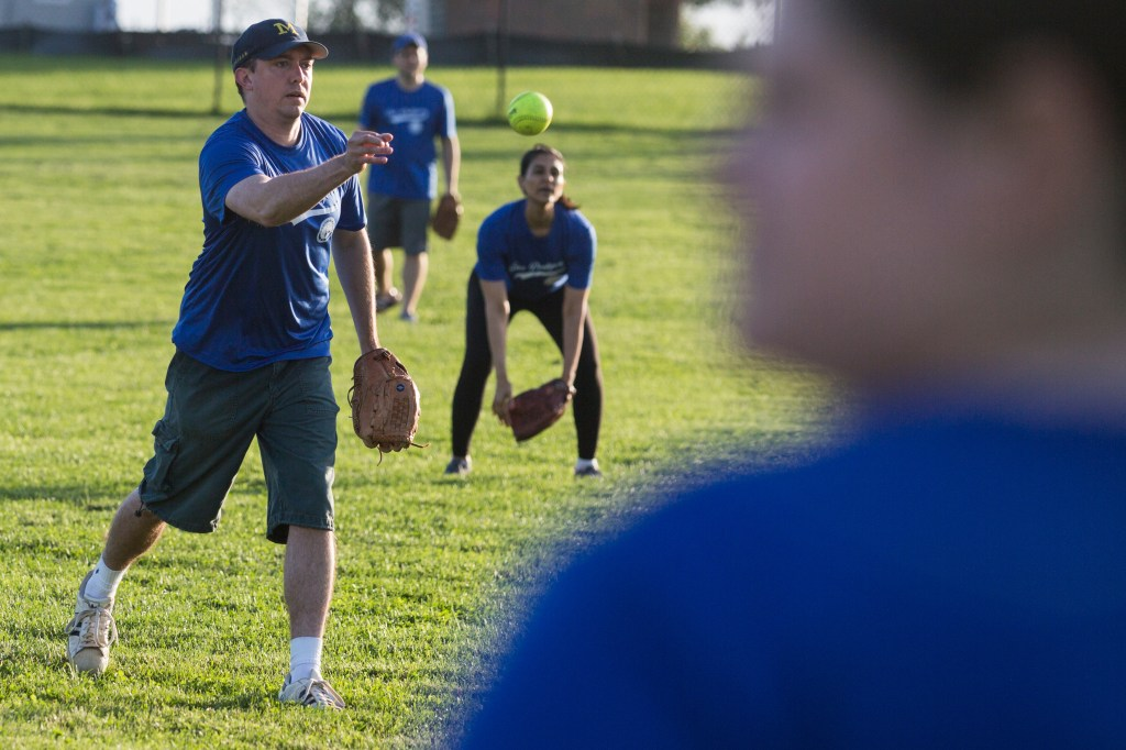 A player on the House softball team the Tax Dodgers pitches the ball during their game against the Immaculate Innings. (Sarah Silbiger/CQ Roll Call)