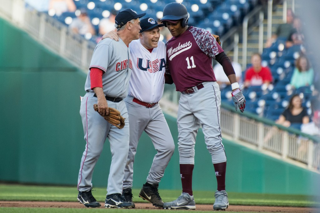 UNITED STATES - JUNE 14: House Majority Whip Steve Scalise, R- La., is helped of the field by Reps. Brad Wenstrup, R-Ohio, left, and Cedric Richmond, D-La., after throwing out the first runner of the night during the 57th annual Congressional Baseball Game at Nationals Park on June 14, 2018. Scalise was critically wounded in last year's Republican baseball practice shooting. The Democrats prevailed 21-5. (Photo By Tom Williams/CQ Roll Call)