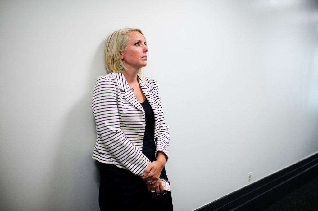 UNITED STATES - JUNE 11: Katie Patru stands outside of a news conference in the Capitol, June 11, 2014, as her boss, House Majority Leader Eric Cantor, R-Va., announces he will be stepping down from the position effective July 31st. (Photo By Tom Williams/CQ Roll Call)