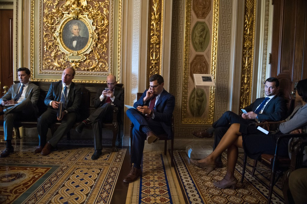 UNITED STATES - JUNE 5: Matt House, center, aide to Senate Minority Leader Charles Schumer, D-N.Y., waits for his boss in the Capitol's Senate Reception Room during the Senate Policy luncheons on June 5, 2018. (Photo By Tom Williams/CQ Roll Call)