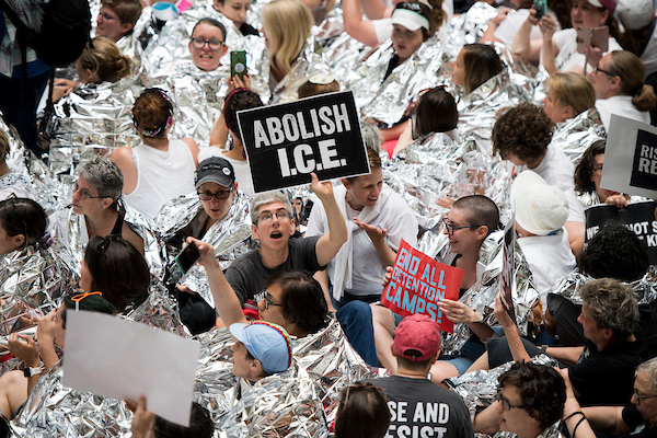UNITED STATES - JUNE 28: Hundreds of women crowd the atrium of the Hart Senate Office Building to protest Trump's immigration policy on Thursday, June 28, 2018. Capitol Police moved in to make arrests to clear the area. (Photo By Bill Clark/CQ Roll Call)