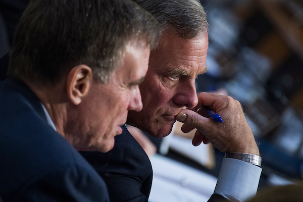 UNITED STATES - JUNE 20: Chairman Richard Burr, R-N.C., right, and Vice Chairman Mark Warner, D-Va., conduct a Senate (Select) Intelligence Committee hearing in Hart Building titled