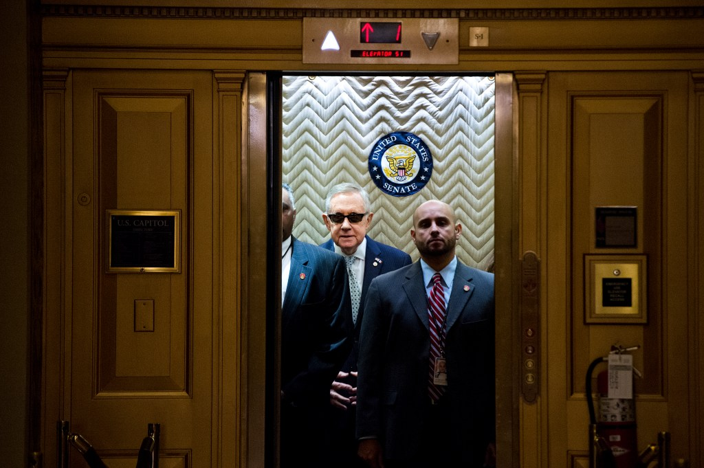 UNITED STATES - NOVEMBER 17: Senate Minority Leader Harry Reid, D-Nev., boards an elevator after signing a condolence book in the Capitol's Senate Foreign Relations Room for the victims of the terrorist attacks in Paris, November 17, 2015. (Photo By Tom Williams/CQ Roll Call)