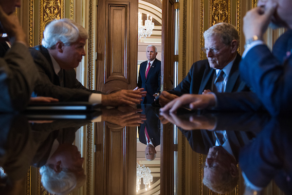 UNITED STATES - JULY 10: Vice President Mike Pence, center, is seen in the Senate Reception Room as Sen. James Inhofe, R-Okla., right, conducts a meeting, after the Senate Policy luncheons in the Capitol on July 10, 2018. (Photo By Tom Williams/CQ Roll Call)