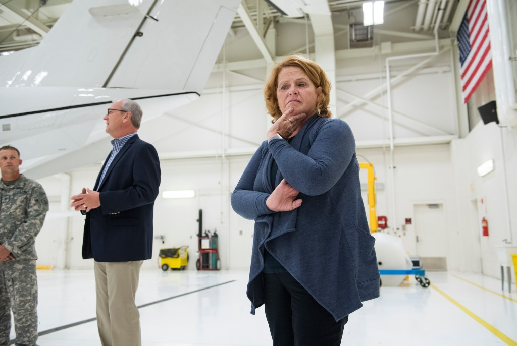 North Dakota Democratic Sen. Heidi Heitkamp, right, is banking on her personal appeal overcoming the Republican lean of the state, which is boosting GOP Rep. Kevin Cramer, left. The two Senate candidates both attended an informal deployment ceremony in Bismarck for National Guardsmen going to the Horn of Africa last week. (Tom Williams/CQ Roll Call)
