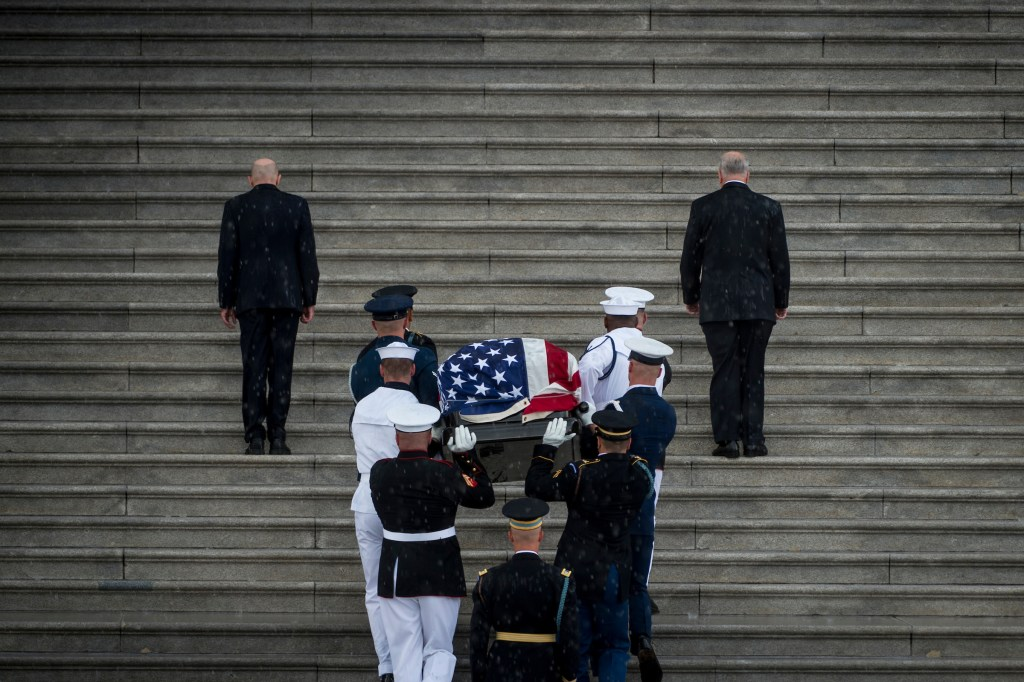 Members of the different services were bearers of McCain's casket into the Capitol. (