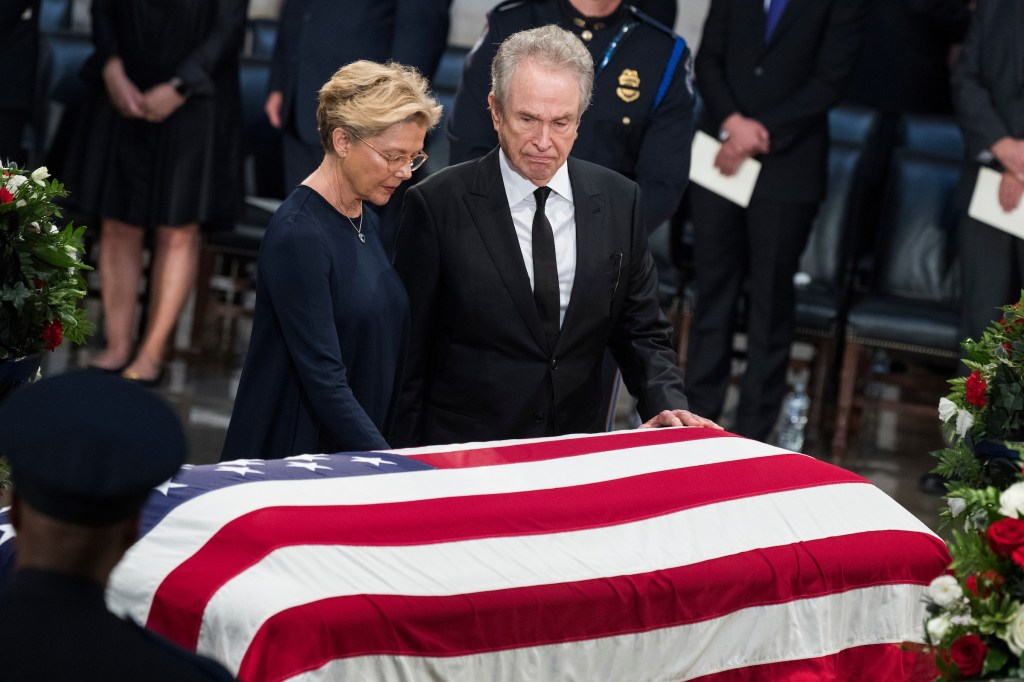 UNITED STATES - AUGUST 31: Warren Beatty and Annette Bening pay respects to the late Sen. John McCain, R-Ariz., as the senator lies in state in the Capitol rotunda on August 31, 2018. (Photo By Tom Williams/CQ Roll Call)