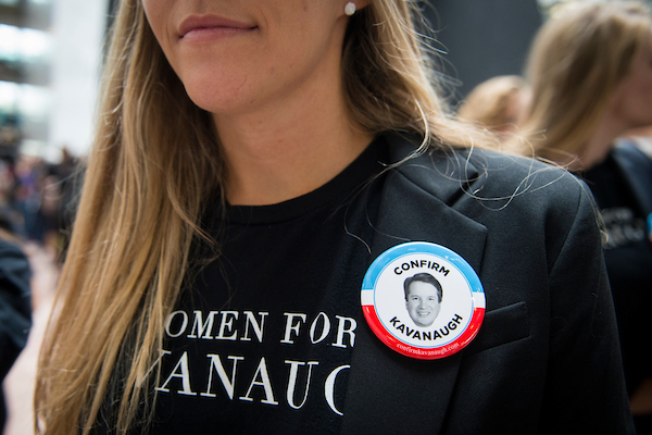 Protests for and against Kavanaugh have been ongoing on Thursday as Ford testifies. In Hart Senate Office Building, a woman wears a button in support of the nominee. (Sarah Silbiger/CQ Roll Call)