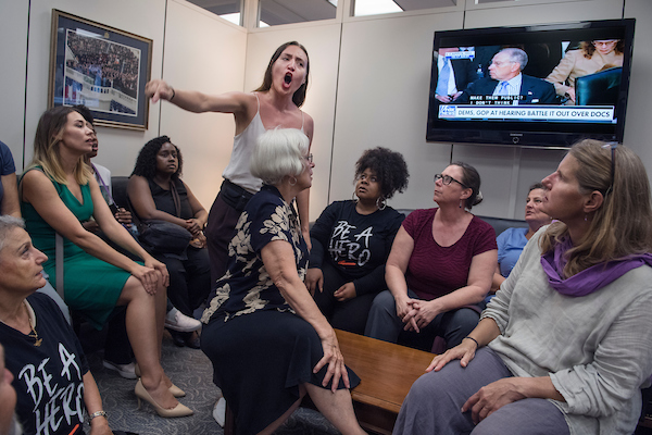 UNITED STATES - SEPTEMBER 06: Protesters, including Breanne Butler, standing, occupy the Hart Building office of Senate Judiciary Committee Chairman Charles Grassley, R-Iowa, to oppose the nomination of Supreme Court nominee Brett Kavanaugh on September 6, 2018. Some protesters cited personal health care issues and are afraid of Kavanaugh's views on the Affordable Care Act. (Photo By Tom Williams/CQ Roll Call)