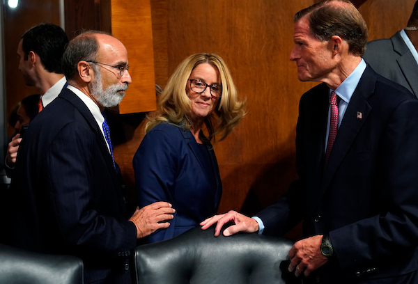 hristine Blasey Ford, center, arrives to testify before the Senate Judiciary Committee on Capitol Hill in Washington, Thursday, Sept. 27, 2018. (POOL/AP Photo/Andrew Harnik)