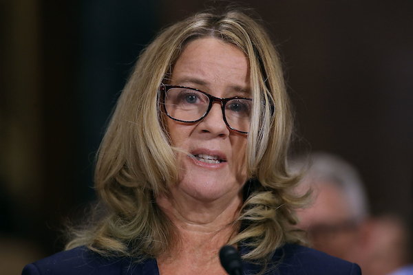 Christine Blasey Ford reads her written remarks as an opening statement following the chairman and ranking member's opening statements. (POOL Photo by Win McNamee/Getty Images)
