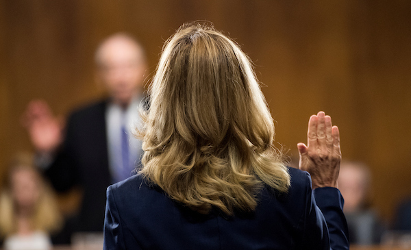 Blasey Ford is sworn in by Chairman Charles E. Grassley, R-Iowa, on Thursday during the Senate Judiciary Committee hearing on the nomination of Brett M. Kavanaugh to be an associate justice of the Supreme Court. (Tom Williams/CQ Roll Call/POOL)