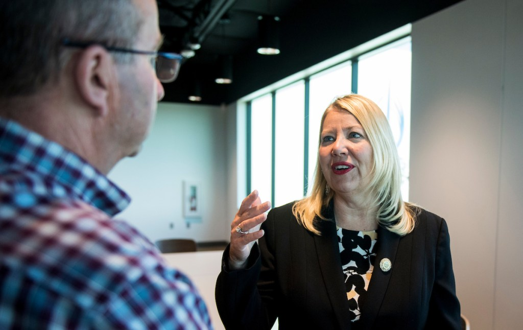 Rep. Debbie Lesko, R-Ariz., speaks with supporters at TYR Tactical in Peoria, Ariz.(Bill Clark/CQ Roll Call)