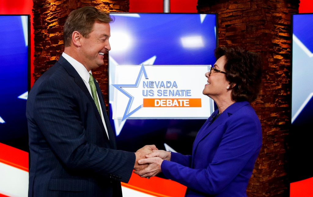 UNITED STATES - OCTOBER 19: Sen. Dean Heller, R-Nev., and his challenger Rep. Jacky Rosen, D-Nev., shake hands before the start of the Nevada U.S. Senate debate at KLAS-TV in Las Vegas on Friday, Oct. 19, 2018. (AP Photo/John Locher/POOL)