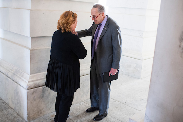 UNITED STATES - OCTOBER 3: Senate Minority Leader Charles Schumer, D-N.Y., and Heidi Heitkamp, D-N.D., talk in the Senate carriage entrance after a vote in the Capitol on October 3, 2018. (Photo By Tom Williams/CQ Roll Call)