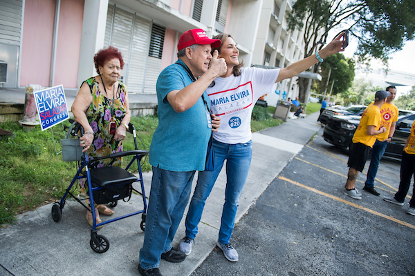 Maria Elvira Salazar, Republican candidate for Florida's 27th Congressional District, talks with voters at a Miami-Dade County housing facility on Election Day in Miami. Salazar is running to keep the seat in GOP hands against former Secretary of Health and Human Services Donna Shalala. (Tom Williams/CQ Roll Call)