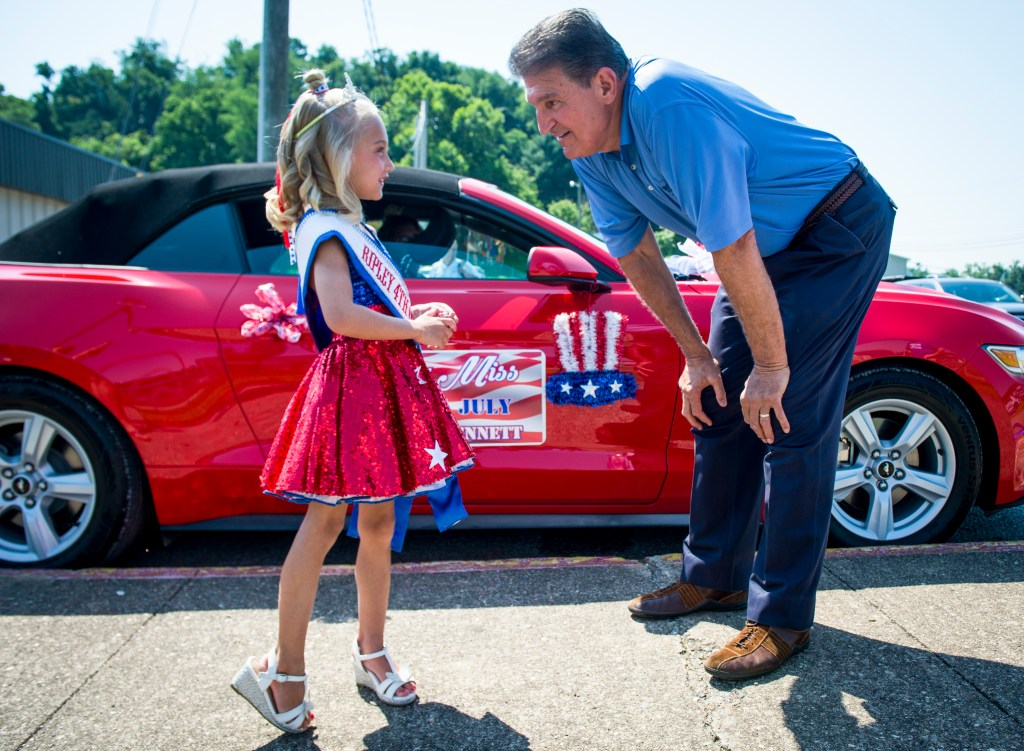 UNITED STATES - July 4: Sen. Joe Manchin, D-W.Va., chats with Little Miss 4th of July before the start of the Ripley 4th of July Grand Parade in Ripley, West Virginia Wednesday July 4, 2018. (Photo By Sarah Silbiger/CQ Roll Call)