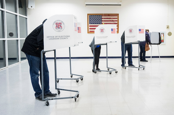 Voters fill out their ballots at Loudoun County High School in Leesburg, Va., on Election Day. (Bill Clark/CQ Roll Call)