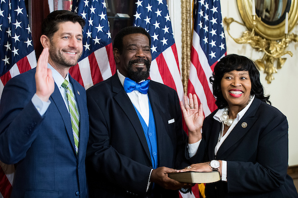 UNITED STATES - NOVEMBER 29: Speaker of the House Paul Ryan, R-Wisc.,left, poses with Rep. Brenda Jones, D-Mich., during her ceremonial swear-in in the Capitol on Thursday, Nov. 29, 2018. (Photo By Bill Clark/CQ Roll Call)