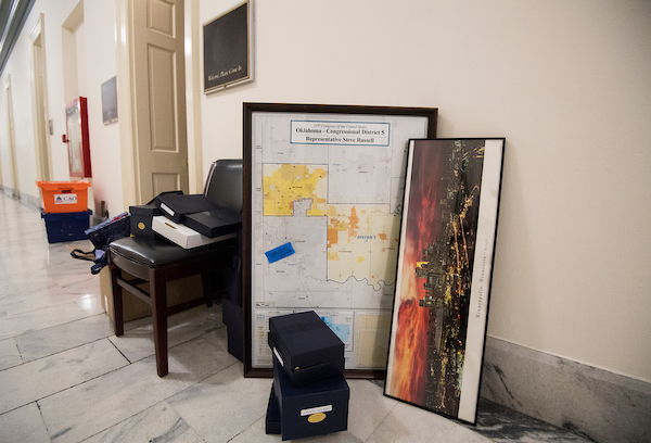 UNITED STATES - NOVEMBER 30: The map for Rep. Steve Russell's district on Oklahoma sits next to a framed photo of the Minneapolis skyline in the Cannon House Office Building as members move out of their offices on Friday, Nov. 30, 2018. (Photo By Bill Clark/CQ Roll Call)