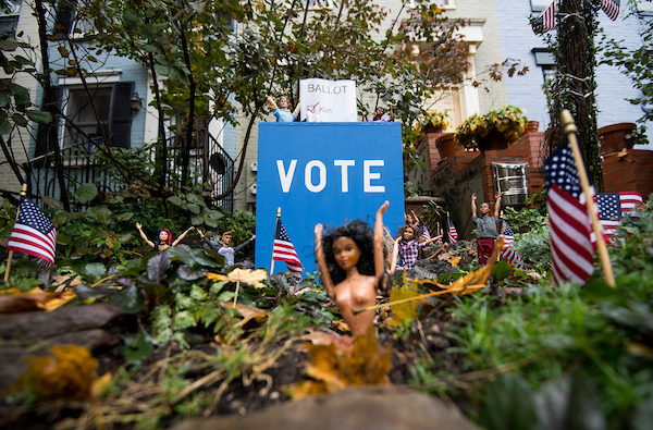 """UNITED STATES - NOVEMBER 5: The election is the theme today at the """"Barbie Pond on Avenue Q,"""" a collection of Barbie dolls posed around their own exclusive pond outside a house in Washington, DC, on Monday, Nov. 5, 2018. The Logan Circle neighborhood attraction features Barbie dolls set up to depict scenes of holidays, seasons, and big events. (Photo By Bill Clark/CQ Roll Call)"""