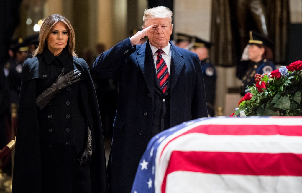 President Donald Trump salutes as First Lady Melania Trump holds her hand over her heart at former President George H.W. Bush's casket in the Capitol Rotunda on Monday, Dec. 3, 2018. (Photo By Bill Clark/CQ Roll Call)