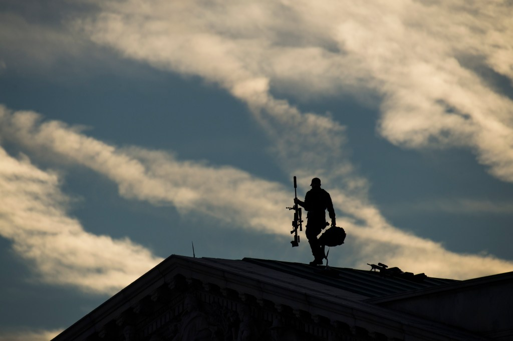 UNITED STATES - DECEMBER 3: A member of security sets up above the House side of the Capitol before the late George H.W. Bush arrived to lie in state in the Rotunda on December 3, 2018. Bush passed away Friday at age 94. (Photo By Tom Williams/CQ Roll Call)