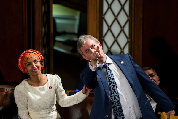 Freshman Rep. Ilhan Omar, D-Minn., and Rep. Matt Cartwright, D-Pa., look up to the gallery in the House chamber before the start of the election of the Speaker of the House on Thursday, Jan. 3, 2019. (Bill Clark/CQ Roll Call)