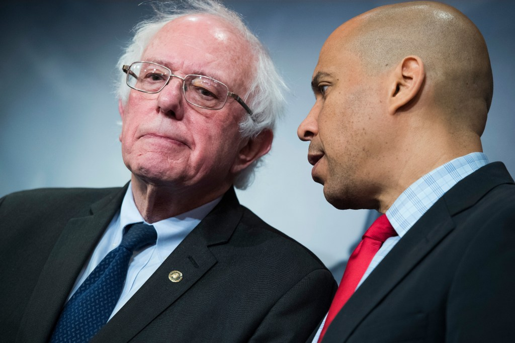 UNITED STATES - JANUARY 10: Sens. Bernie Sanders, I-Vt., left, and Cory Booker, D-N.J., conduct a news conference in the Capitol to introduce a legislative package that would lower prescription drug prices in the U.S. on January 10, 2019. (Photo By Tom Williams/CQ Roll Call)