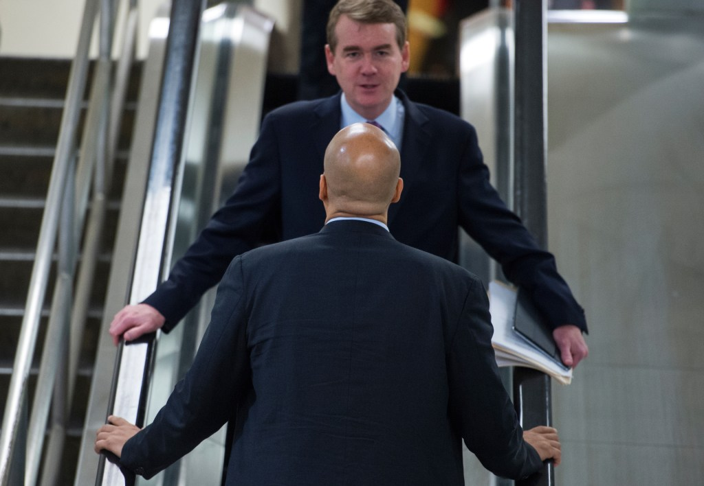 Bennet would join an already crowded Democratic field, including New Jersey Sen. Cory Booker, seen here with the Colorado senator in the Senate basement in 2017. (Tom Williams/CQ Roll Call file photo)
