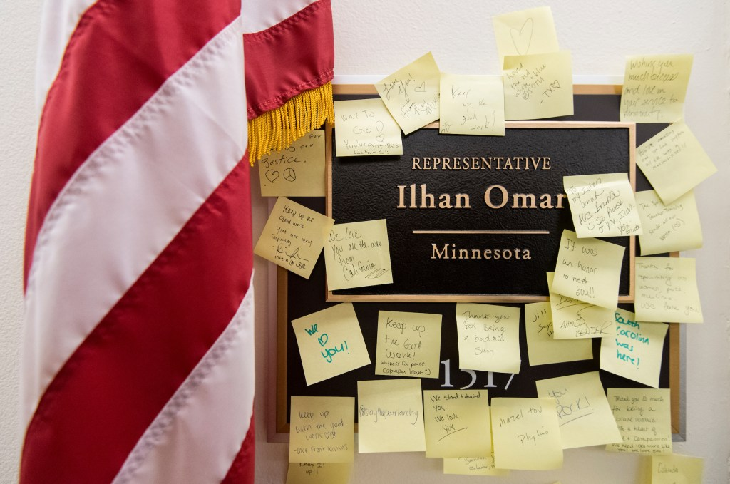 Sticky notes with words of support are posted on the nameplate for Rep. Ilhan Omar, D-Minn., outside her office in the Longworth House Office Building on Monday, Feb. 11, 2019. (Bill Clark/CQ Roll Call)