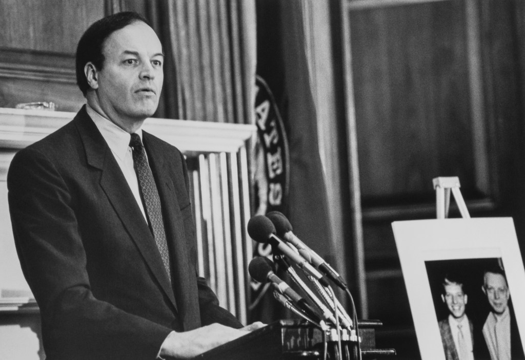 Sen. Richard Shelby, D-Ala., speaks at Tom Barnes memorial service in the Capitol Hill, at right, photo of staffer Tom Barnes and his father. 1992 (Photo by Laura Patterson/CQ Roll Call via Getty Images)